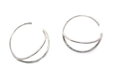 Maanoorbellen van zilver